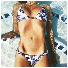 ViX feminine blue and white floral bikini. Gold details with cheeky bottoms.