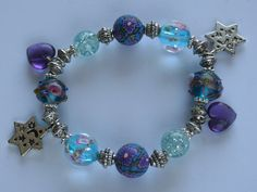 Blue and purple tone glass beads with Tibetan silver spacers and star charms plus purple heart charms