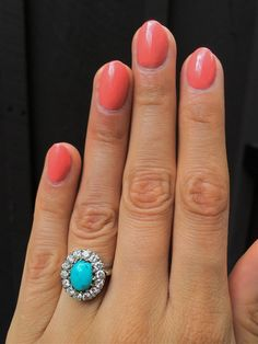much, much smaller. Oval Turquoise With Antique Diamond Halo Engagement Ring