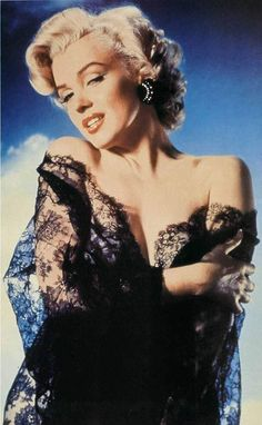 Marilyn in black dress with lace shawl.