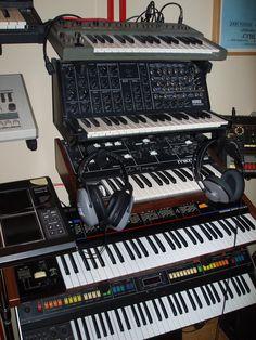 My studio: Roland SH-101, Korg MS-20, Moog Prodigy, Roland Juno-6, Roland Jupiter-8, with Roland TR-808 on the right :)
