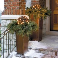 modern copper urns, fir branches, pinecones and lights
