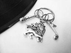 Check out this item in my Etsy shop https://www.etsy.com/uk/listing/489654249/reggae-music-lion-of-judah-charm-keyring