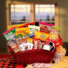 Send this fun get well gift basket to someone in need of cheering up! This basket is full of sweet treats and fun games to help while away the hours spent healing. This Gift Includes: Checkers game se