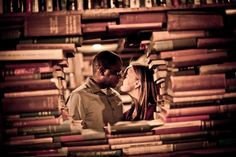 Engagement photo in the #library stacks / Photo by Iconica Photography