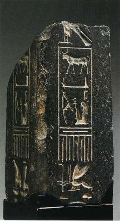 """*OBELISK, black basalt; Eighteenth Dynasty; 38.7 cm; inscribed w/ the Horus name """"The Strong bull, beloved of Maat,"""" private collection."""