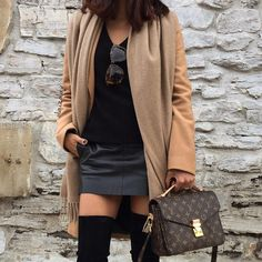 Beige scarf, camel coat, mini skirt, over the knee boots and Louis Vuitton bag for fall style. #streetstyle #camelcoat #miniskirt #beige #fashion #fabfashionfix #overthekneeboots