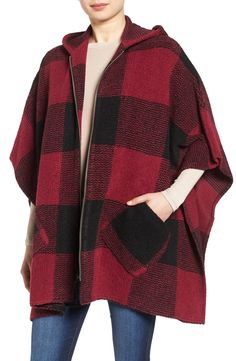 Loving this find from the NSale! Bold buffalo checks lend striking style to this beautiful zip-front cape knit from soft wool-blend yarns and topped with a cozy hood.