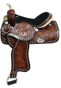 This New, One of a Kind, beautiful saddle features dark oil and medium oil floral tooling that is accented with engraved silver conchos and a cream buck stitch. The saddle is equipped with 4 front D r Barrel Racing Saddles, Barrel Saddle, Horse Saddles, Western Horse Tack, Cowgirl And Horse, Horse Love, Horse Accessories, Horse Supplies, Horse Gear