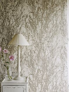 Sanderson Wallpaper - Meadow Canvas (215693) Inspired by a French document from the archive which depicts a photographic silhouette of pressed grasses, this modern country wallpaper design is printed using rotary screen methods to add texture and opacity of colour.