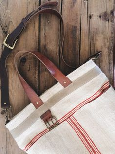 A Well Worn Story   reclaimed striped grain sack and upcycled leather belt tote bag