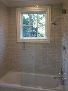 Updated bathroom, tan subway tile, tile molding, no shower curtain...
