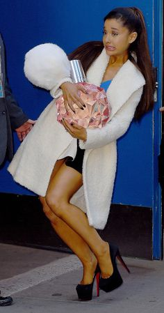 Ariana Grande holds a big bottle of perfume after GMA appearance in New York City