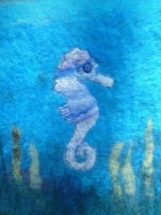 This wallhanging was created by hand-carding a small selection of pre-dyed Merino wools to create a pale blue rainbow palette, which was then lightly worked into a 'pre-felt'. The Seahorse motif was cut from this pre-felt and then applied to a backgrou. Rainbow Palette, Wet Felting, Wooden Beads, Merino Wool, Projects To Try, How To Apply, Embroidery, Facebook, Create