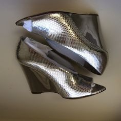 Burberry Prorsum shoreham metallic wedge Burberry Prorsum shoreham metallic peep toe wedge. So beautiful with a gorgeous line. Silver snack embossed leather, Wedge is a mirror metallic. Comes with original box, dust bag and shopping bag. Burberry Shoes Wedges