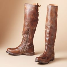 """Sleekly stunning knee boots, inspired by vintage equestrian footwear, are finished with natural leather lacing on lightly distressed leather. Unlined, partial zip and leather sole. Imported. Whole and half sizes 5 to 11. 1"""" heel."""