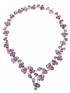 AN 18 CARAT GOLD PINK SAPPHIRE NECKLACE Of scrolling floral and foliate design, composed of a series of varying shades of pink and violet sapphire triplet clusters interspersed with single-stone 'bud' accents, London hallmarks for 18 carat gold Pink Diamond Necklaces, Sapphire Necklace, Sapphire Jewelry, Beaded Necklace, Jewelry Art, Fine Jewelry, Jewelry Design, Saphir Rose, Peridot And Amethyst