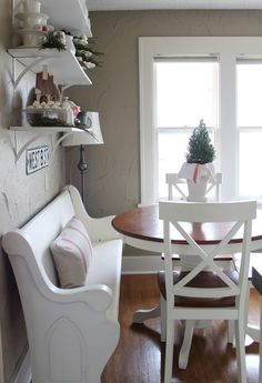 Dining Room decor ideas - small dining room with round table, church pew bench and shelving.