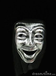 A smiling carnival face mask, part of a Halloween costume.
