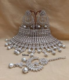 We have a huge collection of Indian Bridal Jewellery set at the best price to add moonlight to your special occasion. Here you can find the stylish and latest Indian wedding jewellery with great deals & discounts. Bridal Jewellery Inspiration, Indian Bridal Jewelry Sets, Wedding Jewelry Sets, Bridal Accessories, American Diamond Jewellery, Fancy Jewellery, Jewelry Design Earrings, Necklace Designs, Party Wedding