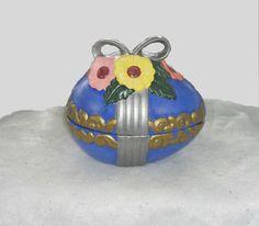 Spring themed flowered covered ceramic egg box. Hand Painted. OOAK ceramic art. #PourBoyCeramics #HandPaintedOOAKCeramicArt