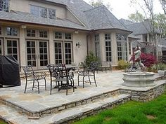 Stamped Concrete.  Inexpensive?  :)