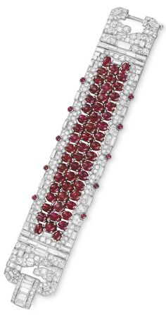 AN ART DECO RUBY AND DIAMOND BRACELET, CIRCA 1930. Centring upon an openwork band of oval-shaped cabochon rubies, to the circular, single and baguette-cut diamond band, trimmed along the sides with cabochon rubies, joined by a single and baguette-cut diamond clasp, mounted in platinum. #ArtDeco #bracelet