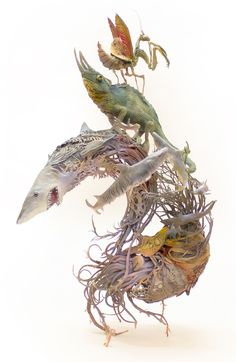 Ellen Jewett (previously) effortlessly blends animals with elements from their environments, creating ceramic pieces that often balance unexpected species together in a singular piece. Each work is highly detailed—flowers, leaves, and vines wrapping themselves around animals from coyotes to cham
