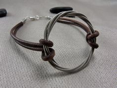 Recycled Guitar String Infinity Circle on Antique brown leather by GuitarStringJewelry, $24.00
