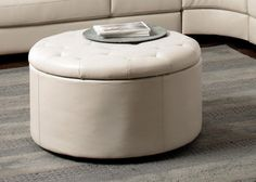 Easy and Stylish Cream Fabric Color Leather-like Storage Ottoman w/ 4 fan shaped ottomans 292.00 with shpng....Also at LV furniture direct 225.00 free shpg