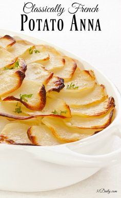 Classically French Potato Anna or Pommes Anna is a beautiful and delicious dish of thinly sliced potatoes with copious amounts of melted butter. The dish is rep Potatoes Anna, French Potatoes, Sliced Potatoes, Potato Dishes, Potato Recipes, Vegetable Recipes, Greek Recipes, French Food Recipes, Vegetarian French Recipes