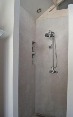 Onze douche cabine van beton cire