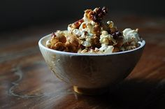Adult cracker-jack - popcorn with maple syrup, black pepper, bacon or pancetta, and bourbon...