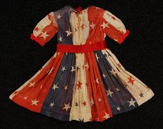 Young Girl's July Centennial Celebration Dress, Red, white and blue flag gauze specially printed with scattered stars, trimmed at neck and short sleeve with red silk satin and wide ribbon belt with bow at waist. Historical Costume, Historical Clothing, Vintage Outfits, Vintage Fashion, Vintage Costumes, Dress Vintage, Patriotic Dresses, 1870s Fashion, Red Silk