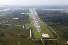 Kennedy Runway Shows Adaptability. The Shuttle Landing Facility at NASA's Kennedy Space Center in Florida is dominated by the 3.2-mile-long runway. Note the Morpheus test area just off the runway. Image Credit:  NASA/Kim Shiflett Denmark Travel, Nasa Images, Kennedy Space Center, Space Exploration, Aircraft Carrier, Travel Information, Aerial View, Free Images, Denmark