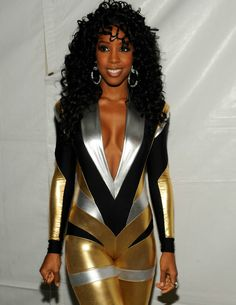 Kelly Rowland. I see skies of blue & clouds of white, the bright blessed day, the dark sacred night, and I think to myself, what a wonderful world.  :)