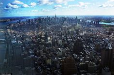 The Manhattan cityscape is seen from the north side of the One World Trade Center observation deck, which is due to open to the public in 2015