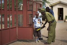 Week of Apr 4-10, 2015 A young boy is screened with a metal detector on Sunday as he enters the compound of a church in Garissa, Kenya. Army and police officials stood guard at churches throughout Kenya on Easter, following a terrorist attack on Garissa University College on Thursday that claimed the lives of 148 students and staff. BEN CURTIS/ASSOCIATED PRESS