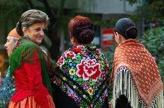three jota singers in traditional dresses from Aragon, Spain.