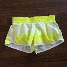 """Nike Yellow 3"""" Dash Dri-Fit Running Shorts Excellent condition. Bright yellow, white and light yellow sides. Tie dye pattern. Modern day fit that is flattering and sporty The lower rise means less excess fabric Designed to sit lower on the hips for zero distraction Wider waistband is flattering and comfortable Internal pocket for small items Adjustable drawcord for a comfortable and adjustable fit Mesh side panels for enhanced range of motion and breathability Attached briefs 3"""" inseam Nike…"""