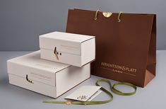 Luxury Packaging Designed by Emma Bristow, produced by Wrapology - like the clasp for the cox and the idea of the lid having a lip that folds down like that