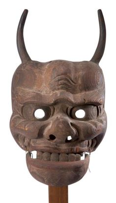 JAPAN    Gigaku old mask depicting a deity fierce retort, and tending to animal traits. Open mouth reveals the teeth and the lower jaw is articulated. Note the natural veins of the wood coming pleated enhance the facial skin. Mishaps, leftover pigments. Wood h.: 42 cm