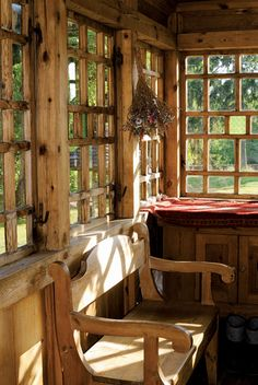~Multi paned windows -rustic wood bench with a gorgeous view of the woods