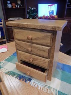 Amish built jewelry box crafted from Oak with a medium finish.  This piece features four cloth-lined drawers to store and help organize your treasures. This also makes a wonderful gift for that someone special on your list! (One currently available)