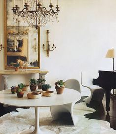 Panton chairs, Saarinen white tulip table round and a crystal chandelier!