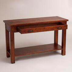 This could work for the TV, under the wall with the star, or backing the love seat.   Madera Console Table | World Market