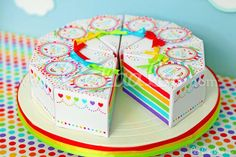 Paper rainbow cake favors at a birthday party!  See more party planning ideas at CatchMyParty.com!