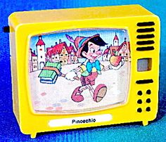 by Plastiskop, made in Germany, light scratches on front does not affect the images, displays various classic scenes of classic Pinocchio Disney scenes,