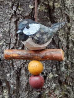 Hand Carved Bird (Chickadee) Ornament. For indoors or outdoors. Carved from White Pine.     Carved from White Pine. Bird is 5 1/2 long...2 1/4