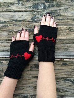 Hand knitted fingerless gloves with red heartbeat pattern. The gloves are made from soft light black yarn. These handknit fingeless gloves are so soft and cozy Fingerless Gloves Knitted, Crochet Gloves, Knit Mittens, Knit Crochet, Crochet Granny, Crochet Wrist Warmers, Hand Warmers, Crochet Accessories, Hand Knitting